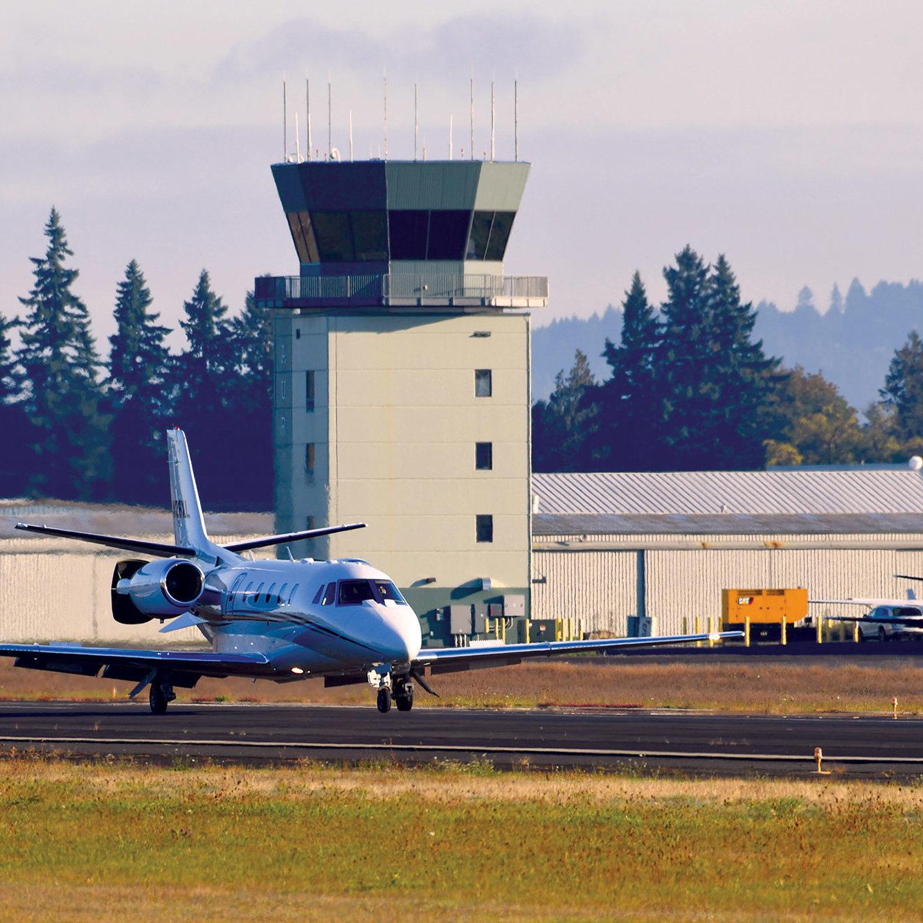 aurora-airport-tower-and-runway-plane